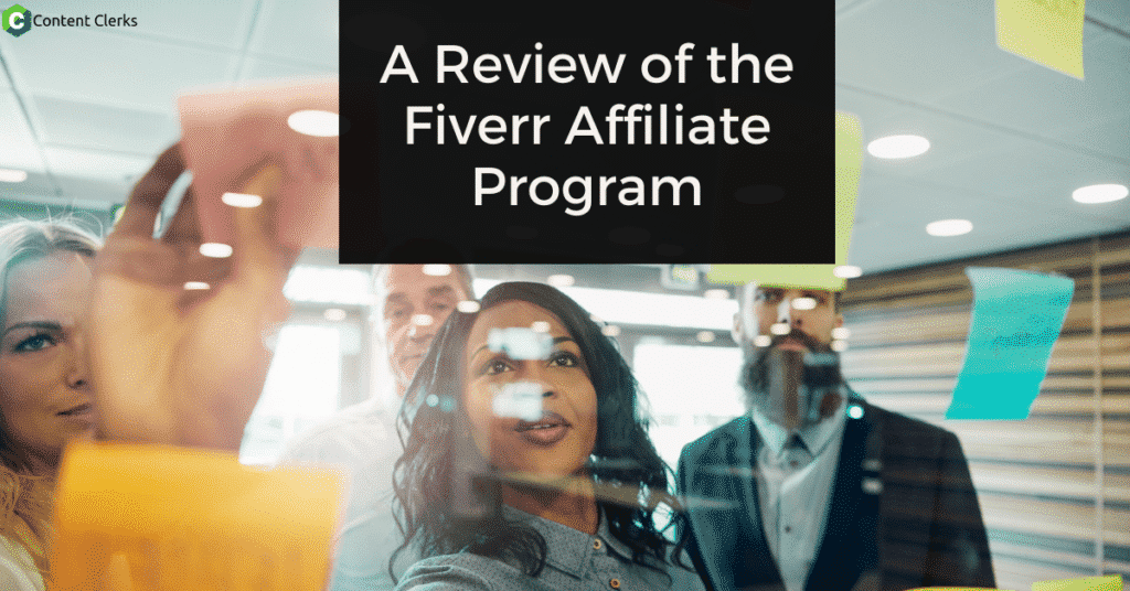 A group people look at a glass board with sticky notes on it-A Review of the Fiverr Affiliate Program